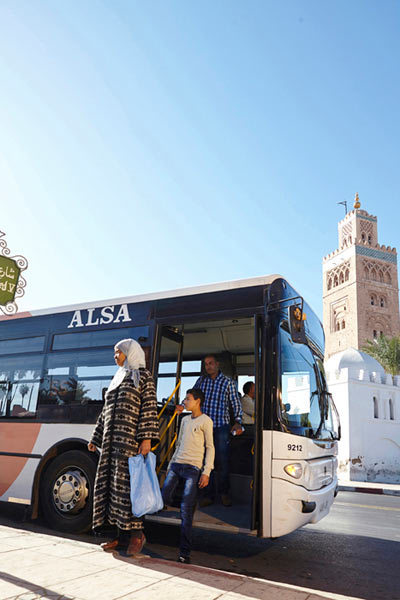 people getting off an ALSA urban bus in Marrakech by Janie Airey photographer