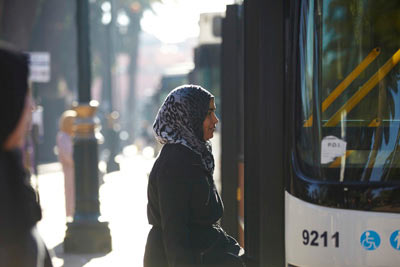women in headscarves getting on morning ALSA bus in Marrakech by Janie Airey photographer