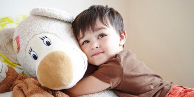 young boy hugging teddy bear by Janie Airey photographer