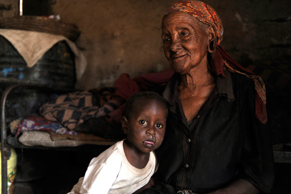 elderly Kenyan woman and child by Janie Airey photographer