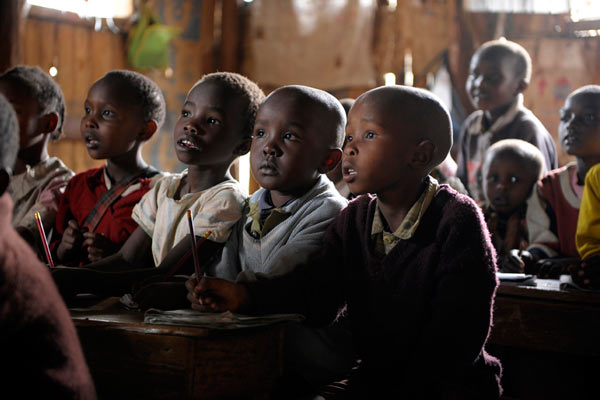 young Kenyan children in crowded primary school by Janie Airey photographer