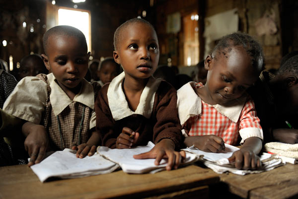 young Kenyan girls in class room by Janie Airey photographer