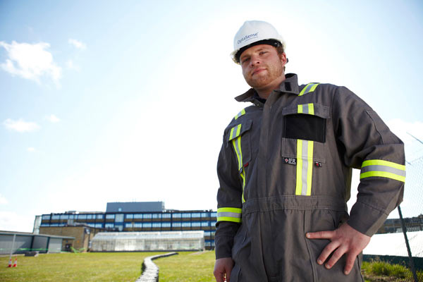 Engineer in overall and hard hat for QinetiQ by Janie Airey photographer