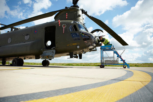 engineer working on Chinook helicopter by Janie Airey photographer