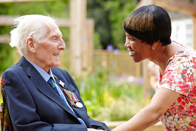 elderly care home resident with care worker at Royal Star & Garter by Janie Airey photographer