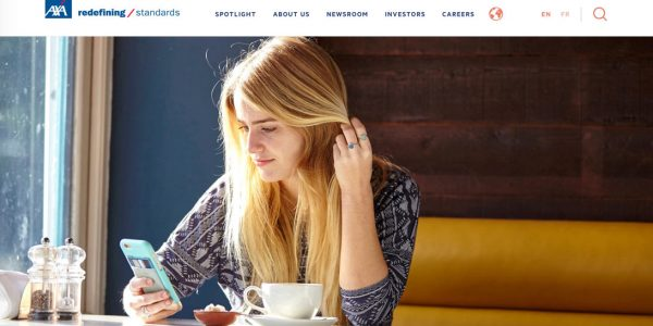 girl with long blonde hair on i-phone for AXA insurance by Janie Airey photographer