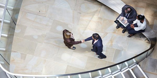 business meeting aerial shot in atrium by Janie Airey photographer