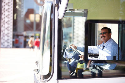 ALSA urban bus driver in Marrakech Morocco by Janie Airey photographer