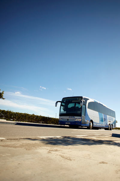 ASLA bus with blue sky in Spain by Janie Airey photographer
