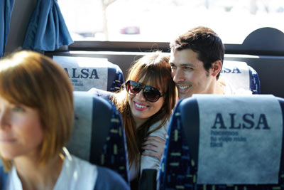 couple smiling on ALSA Bus in Spain by Janie Airey photographer