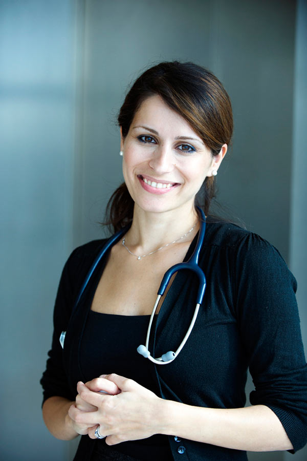 portrait of female doctor smiling with stethoscope by Janie Airey photographer
