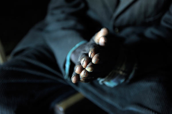 Close up of elderly black man's hands in Kenya by Janie Airey photographer