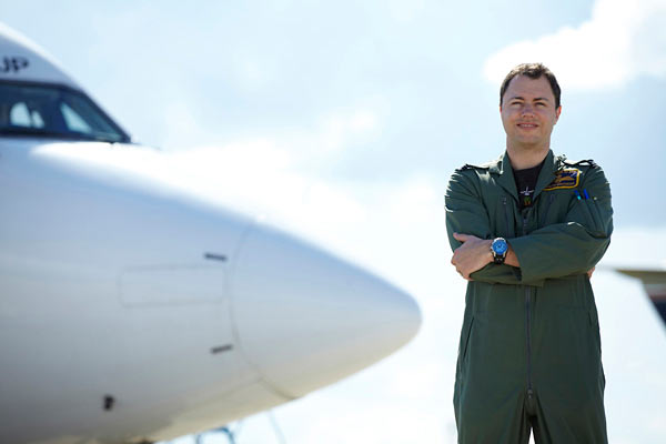 portrait of trainee pilot and aeroplane by Janie Airey photographer