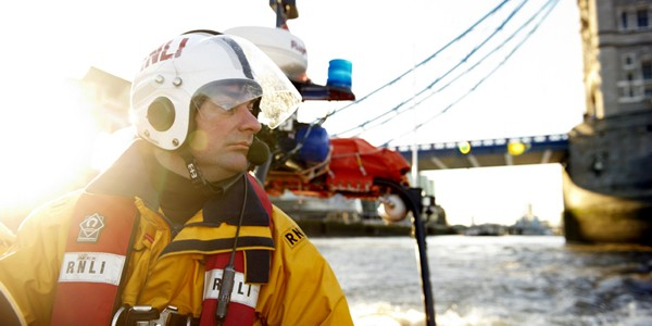 RNLI crew member on River Thames in London by Janie Airey photographer