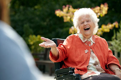 elderly care home resident laughing at Royal Star & Garter by Janie Airey photographer