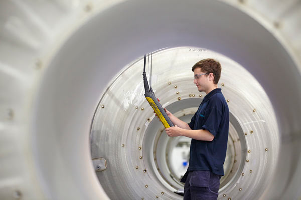 Siemens graduate in factory making MRI scanners by Janie Airey photographer