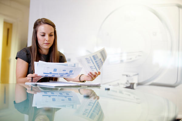 female Siemens employee looking through data sheets by Janie Airey photographer