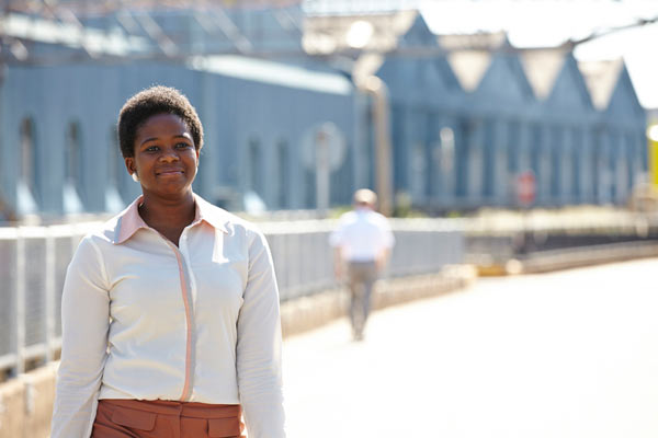 young black woman outside Siemens depot by Janie Airey photographer