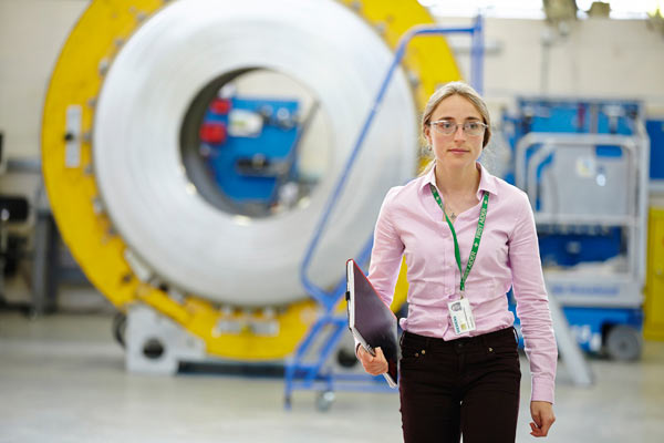 young woman with safety glasses in Siemens factory by Janie Airey photographer