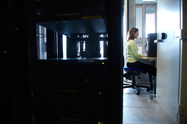 young woman in computer room of Siemens depot by Janie Airey photographer
