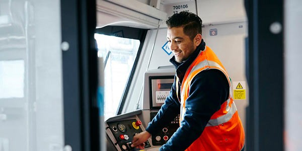 Rail technician testing in train cab for Siemens UK
