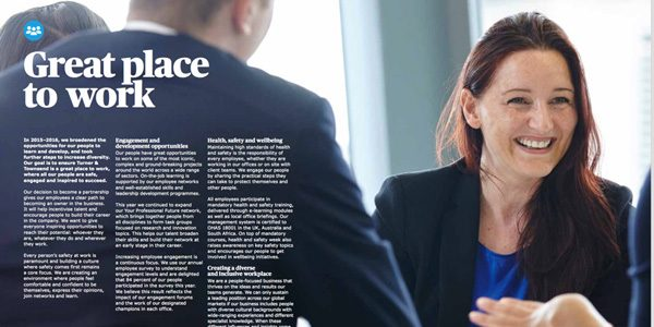 young business woman in dark suit smiling in meeting by Janie Airey photographer